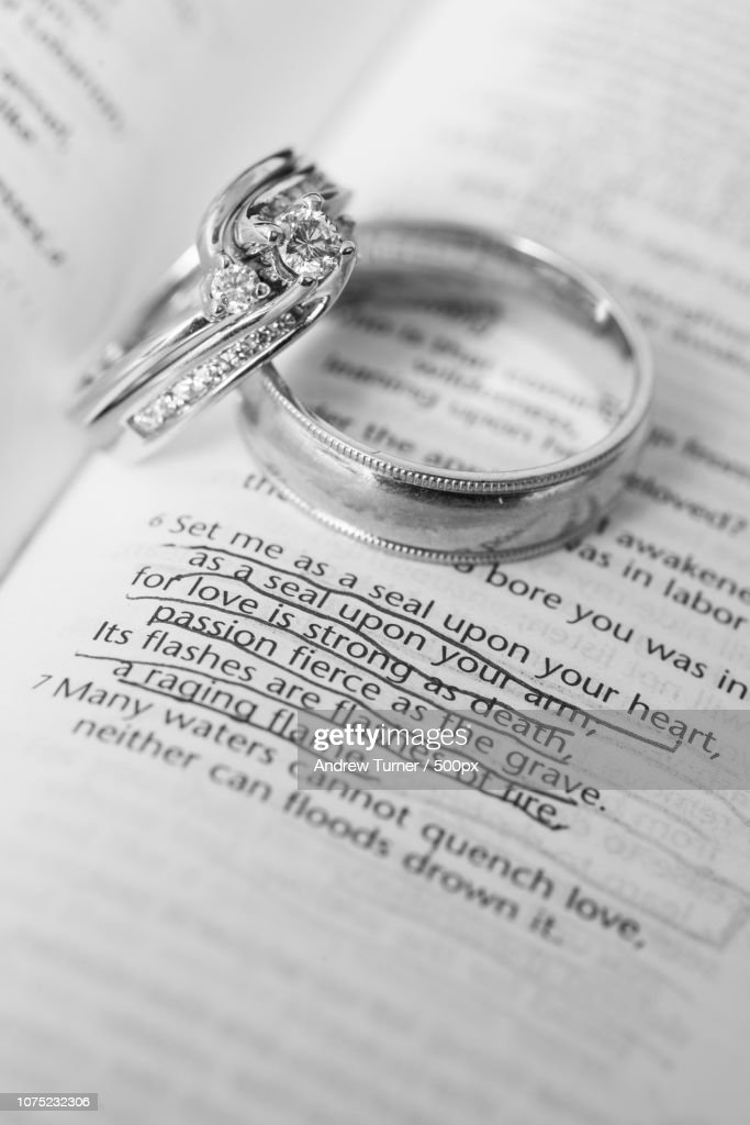 Wedding Rings On Bible Verse Stock Photo Getty Images
