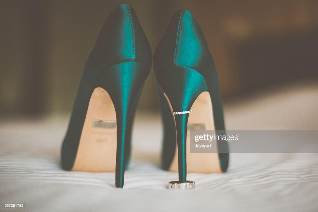 Wedding Rings On Green High Heels Stock Photo