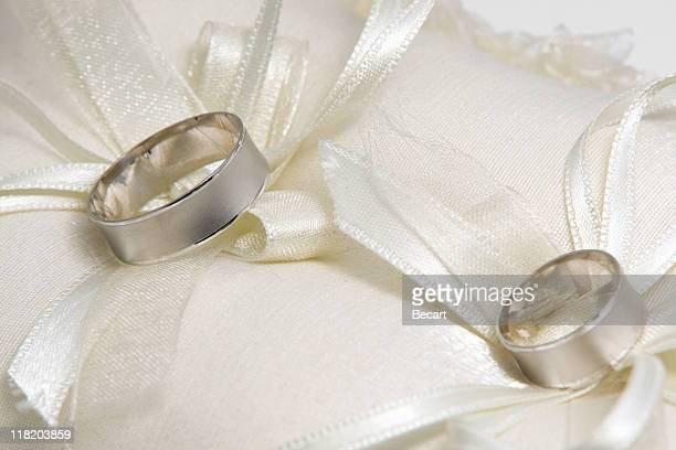 wedding rings on pillow - white gold stock pictures, royalty-free photos & images