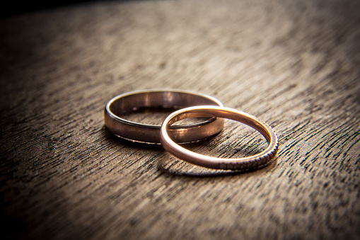 Wedding rings on wood 972420664