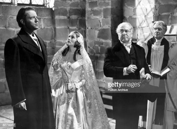 A wedding scene between Orson Welles and Joan Fontaine from the film 'Jane Eyre' adapted from the novel by Charlotte Bronte The film was directed by...