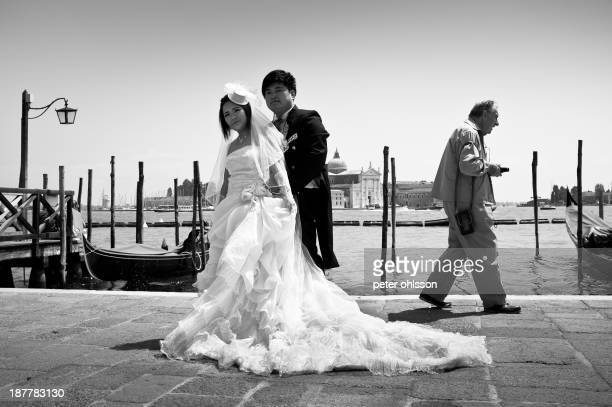 Wedding shoot in Venice crashed by a tourist walking into frame