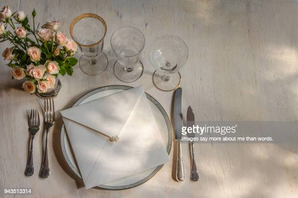 a wedding table setting bathed by the sun. still life - invitation stock pictures, royalty-free photos & images