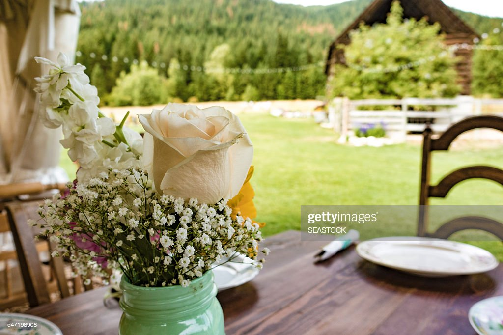 Wedding Table Settings With Flowers, Utensils, Chairs and Dishes : Stock Photo