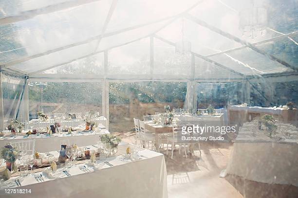 Wedding tables in marquee with light rain