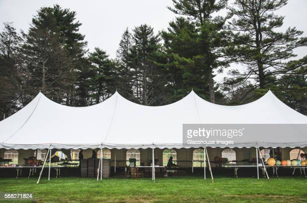 wedding tent on grass beneath trees - entertainment tent stock pictures, royalty-free photos & images