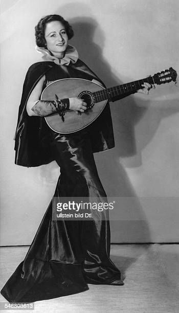 Wedekind Pamela * Actress Singer Translator Germany fulllength portrait with lute in a play 1937 photographer Charlotte Willott Published by 'BZ'...