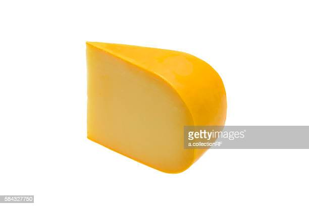 A wedge of Gouda cheese