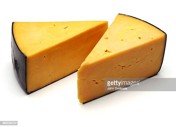Wedges of cheddar on white