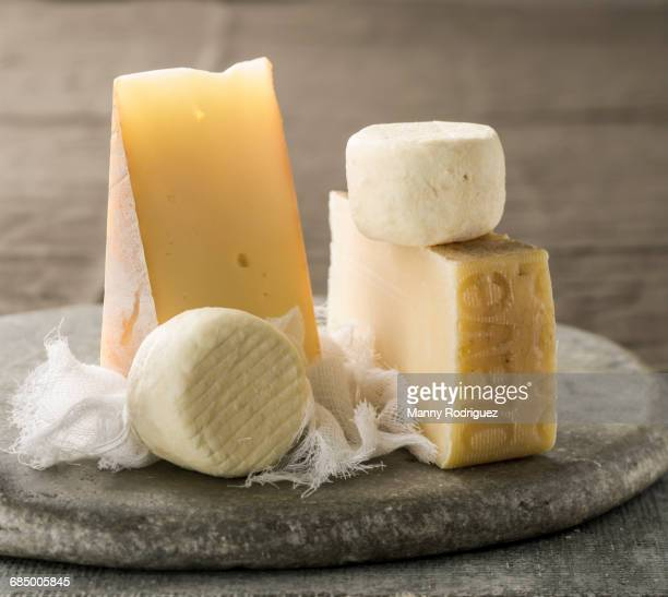 Wedges of cheese and cheesecloth