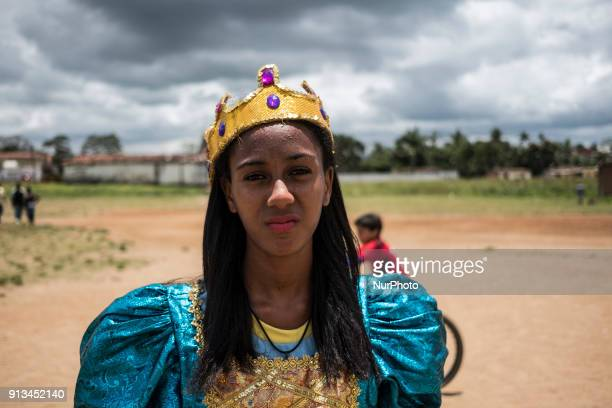 Wedja Patrícia poses for a photo with her queen fantasy in the city of Nazaré de Mata in Northeast Brazil on September 24 2017