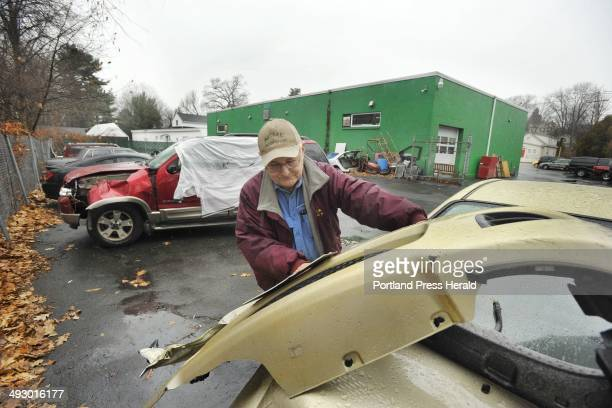Wednesday December 21 2011 York Stephens shop manager at Acme Body Shop on Lincoln Street in South Portland surveys the damage to one of two vehicles...