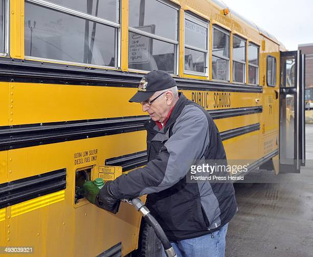 Wednesday March 14 2012 Bob Nadler a bus driver for Portland for the past 14 years fills his bus with diesel fuel at the Portland Department of...
