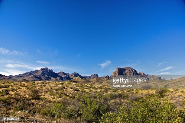 a wednesday morning view of the chisos mountains (wide angle) - chisos mountains stock pictures, royalty-free photos & images