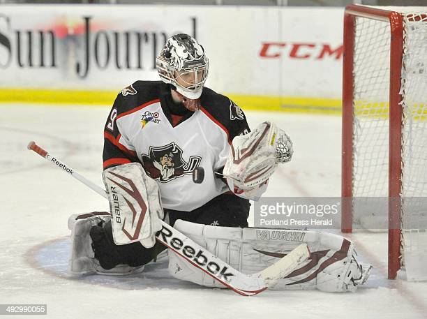Wednesday November 14 2012 Portland Pirates vs the Worcester Sharks at the Colisee in Lewiston Pirate goalie Mark Visentin bats away a shot in the...