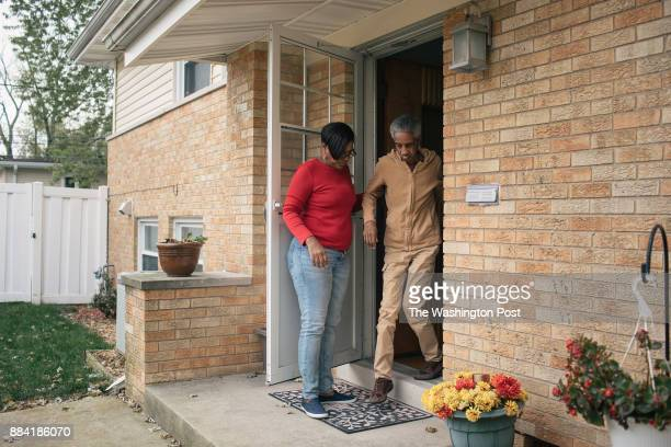 Alantris Muhammad walks out of her home with her mother Dorris West who suffered a car accident that left her unable to walk or eat on her own eleven...