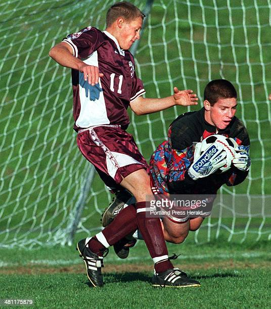 Wednesday, October 6, 1999 -- Cape Elizabeth goalie David Croft made a diving save to come up with a loose ball in front of Gorham's, Thomas McLeod.