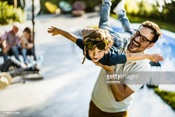 wee daddy i'm flying! - one parent stock pictures, royalty-free photos & images