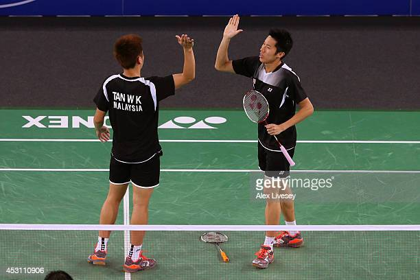 Wee Kiong Tan and Mas Wei Shem of Malaysia celebrate victory in the Men's Doubles Gold Medal Match against Chayut Triyachart and Danny Chrisnanta of...