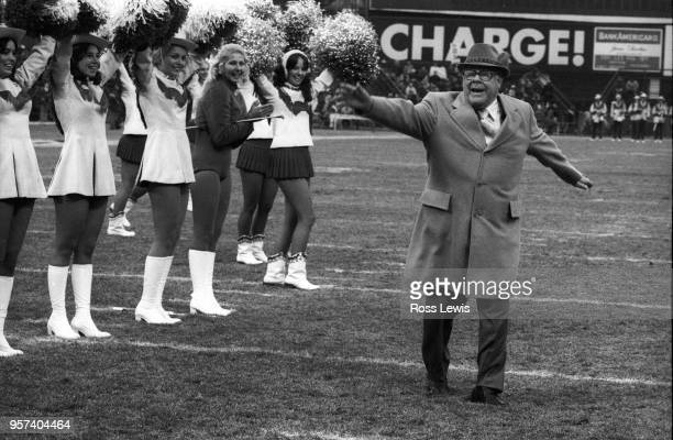 Weeb Ewbank former coach of the Baltimore Colts and New York Jets of the National Football League waves 'farewell' to fans during a special ceremony...