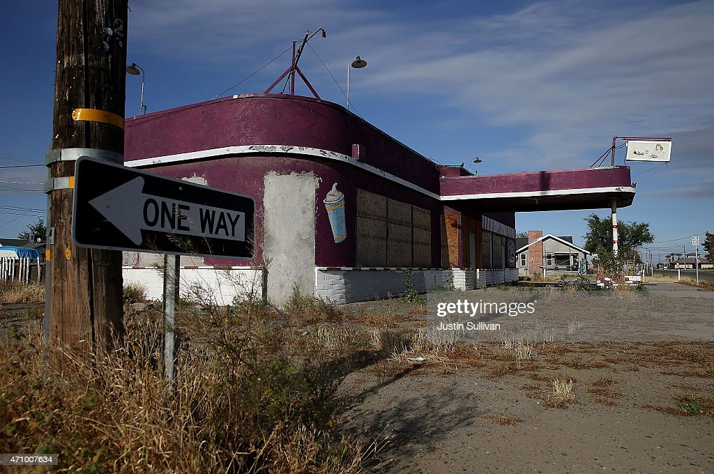 Weeds grow around an out of business restaurant on April 24, 2015 in Stratford, California. As California enters its fourth year of severe drought, small Central Valley farming towns are struggling to survive and are experiencing dwindling populations as farms scale back operations and lay off workers due to lack of water to irrigate crops.