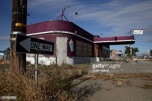 Weeds grow around an out of business restaurant on April 24 2015 in Stratford California As California enters its fourth year of severe drought small...