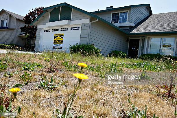 Weeds grow in the yard outside a foreclosed home in Vallejo California US on Wednesday May 7 2008 The city is fighting to tear up its labor contracts...