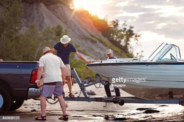 week-end activities between senior brothers - boat stock pictures, royalty-free photos & images