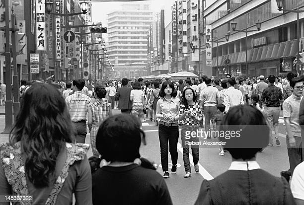 Weekend shoppers crowd the Ginza district in Tokyo Japan