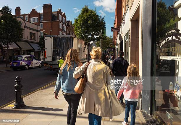 weekend shoppers in soho, london - shaftesbury avenue london stock photos and pictures