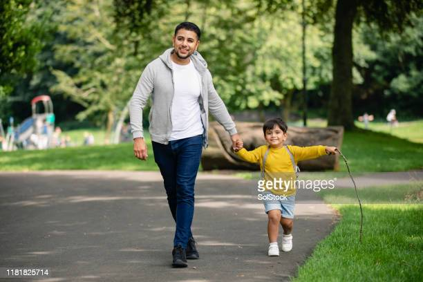 weekend walk with dad - casual clothing stock pictures, royalty-free photos & images