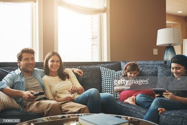 weekends filled with no worries - family watching tv stock pictures, royalty-free photos & images