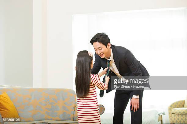 weekly daughter the father of the tie - man bending over from behind stock photos and pictures