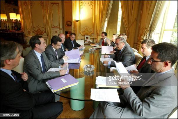Weekly meeting between the Prime Minister Jean Pierre Raffarin, Nicolas Sarkozy, Francois Perol, Claude Gueant and Dominique Bussereau on May 3, 2004...