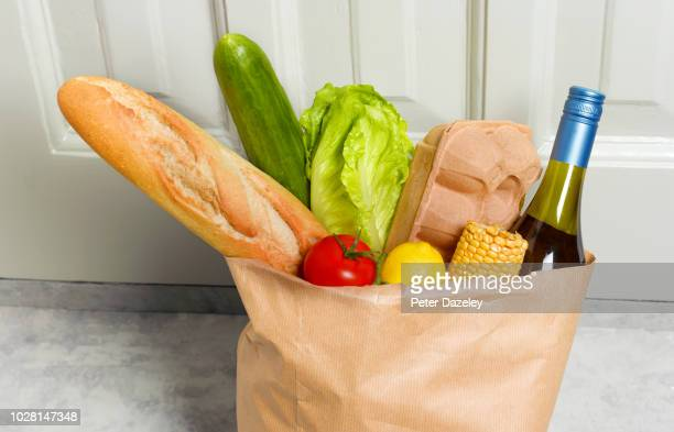 weekly shop in paperbag - grocery delivery stock pictures, royalty-free photos & images