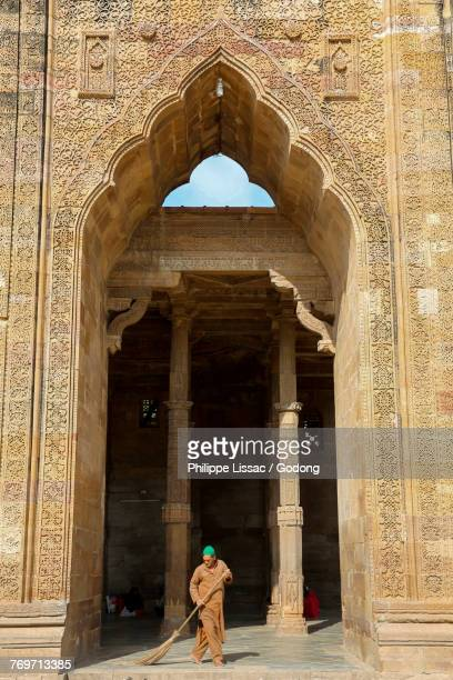 Weeper in the ruins of Adhai-din-ka-jhonpra mosque (known as the 2 1/2 day shed relating to the legend that it was built in 2 1/2 days), Ajmer, Rajasthan. India.