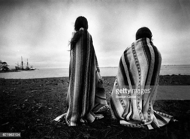 Weetoomoo Carey left and her sister Jackolynn Carey Wampanoag Nipmucs from Mashpee look across to the Mayflower replica anchored near Plymouth Rock...