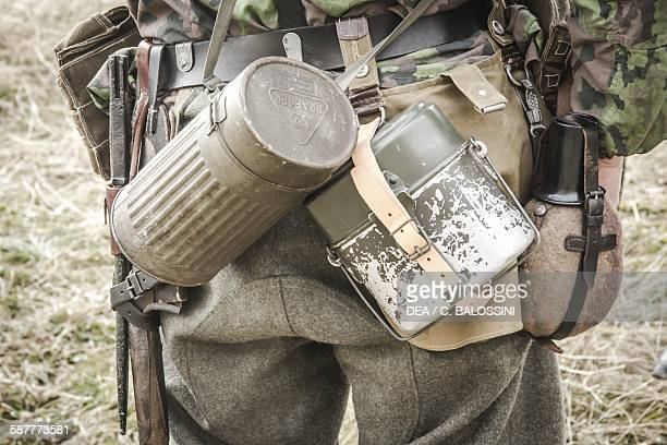 Wehrmacht soldier with mesh kit water bottle and cylindrical container for antigas mask Western Front Second World War 20th century Historical...
