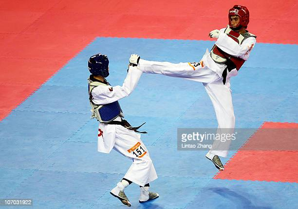 Wei chen Yang of Chinese Tai bei with Pulatov Rustamjon of Uzbekistan competes in the men's under 58kg quarterfinals bout at Guangdong Gymnasium...