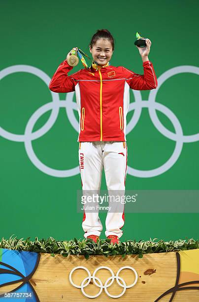 Wei Deng of China celebrates after winning the gold medal during the Women's 63kg Group A Weightlifting contest on Day 4 of the Rio 2016 Olympic...