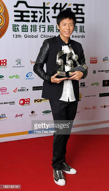 Wei Li An of Chinese Taipei with his 3 awards at the 13th Global Chinese Music Awards at Putra Stadium on October 5 2013 in Kuala Lumpur Malaysia