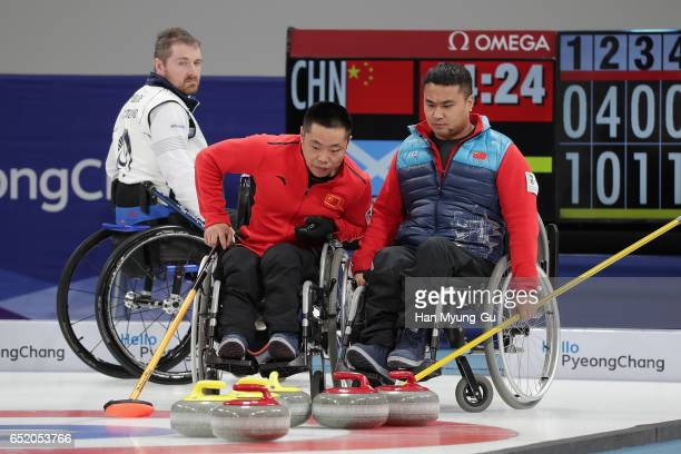 Wei Liu and Haitao Wang from China react during the final in the World Wheelchair Curling Championship 2017 test event for PyeongChang 2018 Winter...