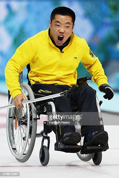 Wei Liu of China celebrates after winning a point during the semifinal match between China and Canada on day eight of Sochi 2014 Paralympic Winter...