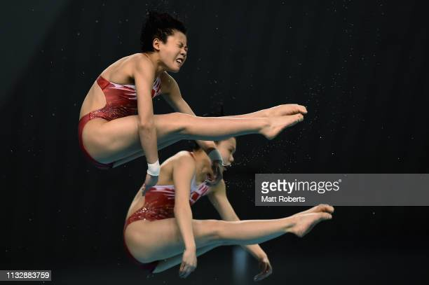 Wei Lu and Jiagi Zhang of China compete during the 10m Synchro Platform Women's Final on day one of the FINA Diving World Cup Sagamihara at...