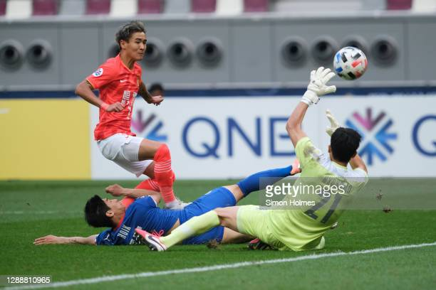 Wei Shihao of Guangzhou Evergrande scores during the AFC Champions League Group G match between Guangzhou Evergrande and Suwon Samsung Bluewings at...