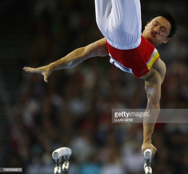 Wei Yang of China competes on the parallel bars during the men's individual all-around final of the 40th World Artistic Gymnastics Championships 07...