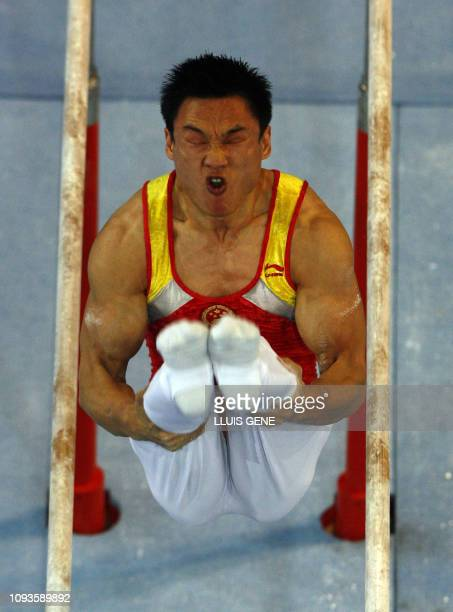 Wei Yang of China competes on the parallel bars during the men's team final of the 40th World Artistic Gymnastics Championships 06 September 2007 at...