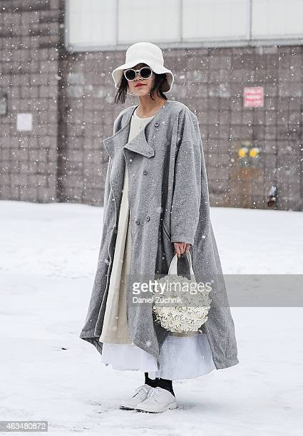 Wei Yi is seen outside the Alexander Wang show with a Comme des Garcons bag on February 14 2015 in New York City