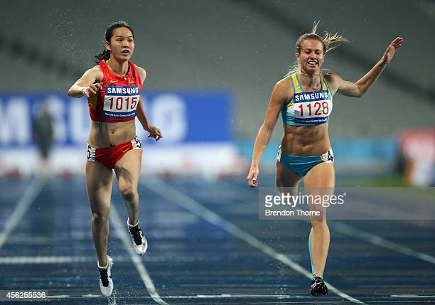 Wei Yongli of China and Olga Safronova of Kazakhstan compete in the Women's 100m Final during day nine of the 2014 Asian Games at Incheon Asiad Main...