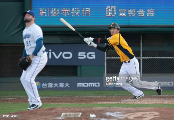 WeiChen Wang of CTBC Brothers hit a trippple at the top of the 3rd inning during the CPBL game between Fubon Guardians and CTBC Brothers at the...